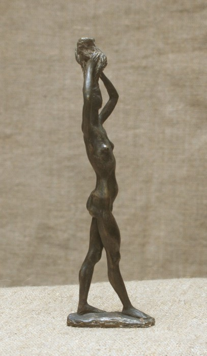 Female with raised hands by Mikhail Pertsev, bronze on sculpture